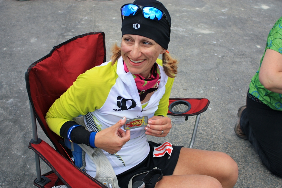 Emily Berriochoa showing her finisher buckle at Salt Flats 100