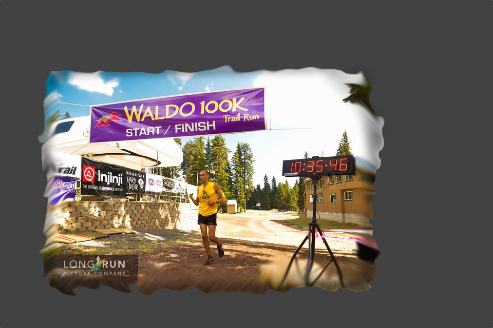 picture of Yassine Diboun crossing the finish line of the waldo 100k ultra marathon