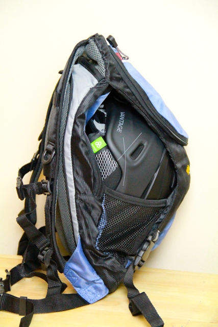 picture of Outdoor Product Ripcord backpack from side with helmet stowed