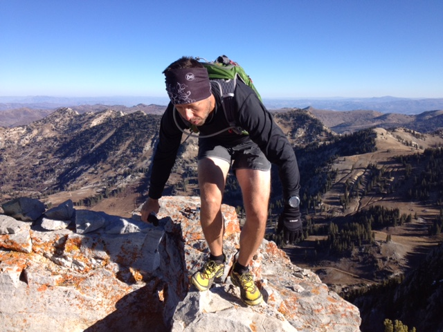 Summiting Devils Castle wearing the UltrAspire Zygos