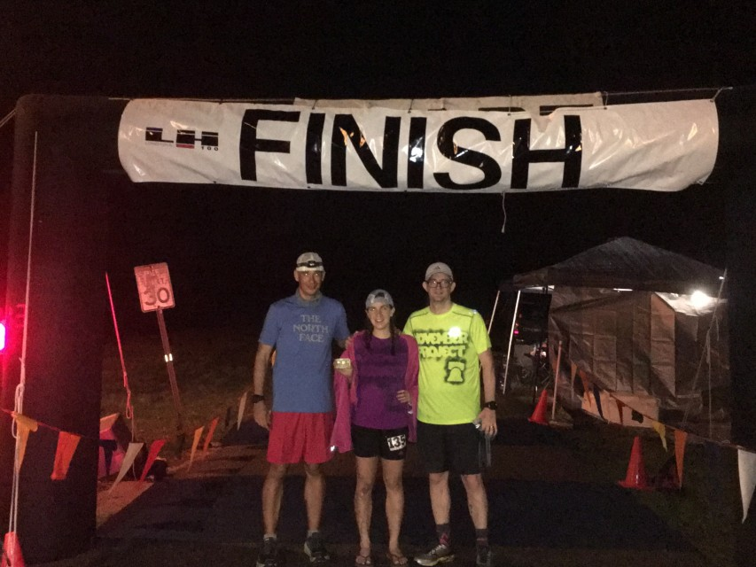 At the finish line with my two pacers, Jesse and John.